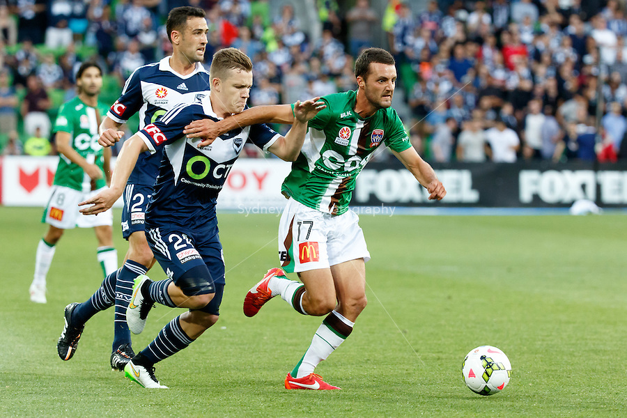 James VIRGILI (17) of the Jets and Scott GALLOWAY of the Victory fight for the ball in round 12 A-League match between Melbourne Victory and Newcastle Jets at AAMI Park in Melbourne, Australia during the 2014/2015 Australian A-League season. Melbourne def Newcastle 1-0
