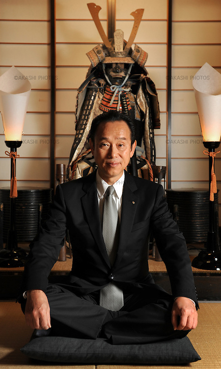 Mr. Hidekazu Tone, owner of the Lamp no Yado, sitting in front of a samurai armor, Yoroi, in his luxurious Japanese ryokan, located on the tip of Noto Peninsula.