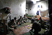 United States advisors and trainers sit down for dinner with their Afghan counterparts at a remote outpost in the heart of the Pech Valley - Kunar, Afghanistan. Teams of seasoned soldiers from the United States (mostly former Special Forces) are being tasked with training and advising many of the mid-level Afghan National Army commanders in the field.