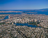 historical aerial photograph Oakland, California looking toward the Port of Oakland, the Bay Bridge, San Francisco and the Golden Gate.  Please note that this aerial photograph was taken December 3, 1999 and shows the old span of the Bay Bridge before its replacement.  For more recent version of this view, please contact Aerial Archives.