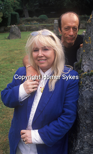 Dwina Gibb and Robin Gibb of the pop group Bee Gees 2000s at their home in the Home Counties UK. Dwina is a Druid and she is seen here with part of her own stone Druid circle.