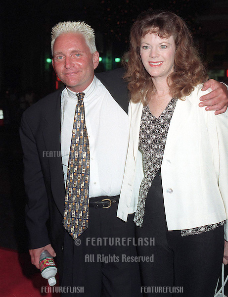 "08SEP97: Actor ERIC DOUGLAS & girlfriend BARBARA WHINNERY at the premiere of ""The Game,"" which stars his brother Michael Douglas & Sean Penn. The premiere was at the Chinese Theatre in Hollywood."
