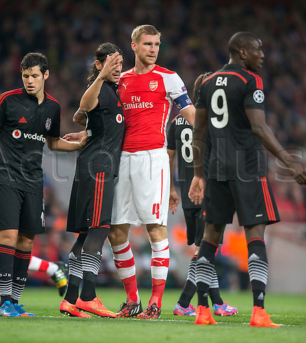 27.08.2014.  London, England. Champions League Qualifying 2nd Leg. Arsenal versus Besiktas. Arsenal's Per Mertesacker is tightly marked during a corner.