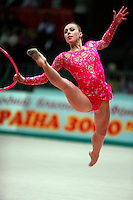 "Inna Zhukova of Belarus begins split leap with hoop at 2008 World Cup Kiev, ""Deriugina Cup"" in Kiev, Ukraine on March 23, 2008."