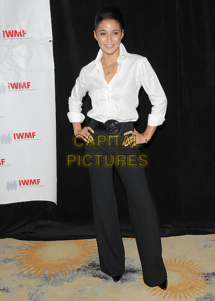 EMMANUELLE CHRIQUI.attends The International Women's Media Foundation's Courage in Journalism Awards held at The Beverly Hills Hotel in Beverly Hills, California, USA, October 16th 2008                                                                     .full length white shirt hands on hips black belt buckle wide leg trousers .CAP/DVS.©Debbie VanStory/Capital Pictures