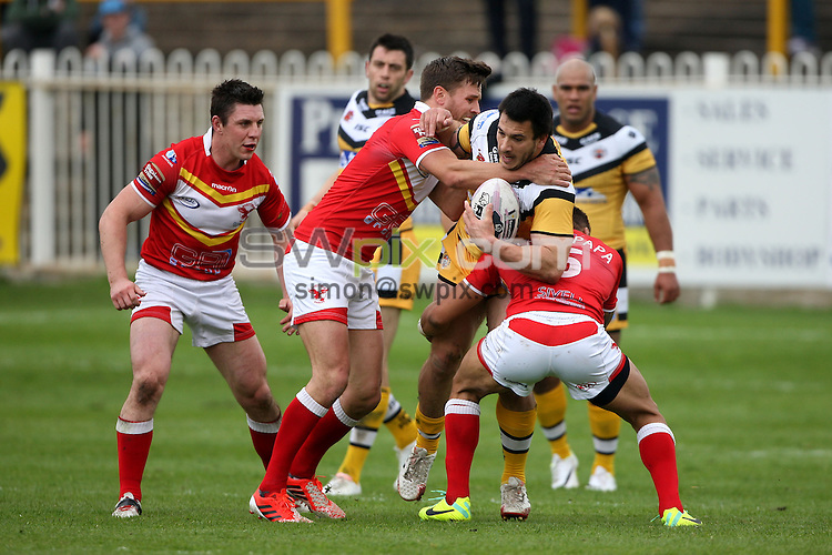 Picture by Harry Whitehead/SWpix.com - 27/04/2014 - Rugby League - Tetley's Challenge Cup - Castleford Tigers v Sheffield Eagles - The Mend A Hose Jungle, Castleford, England - Castleford Tigers' Justin Carney is tackled by Sheffield Eagles' Misi Taulapapa