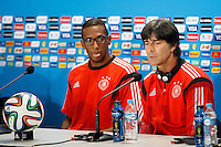 Germany manager Joachim Low talks as Jerome Boateng sticks his tongue out during the press conference