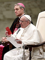 Pope Francis holds up a red ticket, needed to participate in his weekly general audiences, during his general audience in the Paul VI Hall at the Vatican, on Jan.uary 11, 2017. The pontiff stressed that to attend his public audiences the ticket is free of charge after he found out that there are persons who are selling the tickets. <br /> UPDATE IMAGES PRESS/Isabella Bonotto<br /> <br /> STRICTLY ONLY FOR EDITORIAL USE