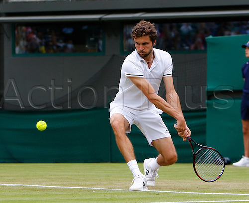 30.06.2016. All England Lawn Tennis and Croquet Club, London, England. The Wimbledon Tennis Championships Day Four. Number 16 seed, Gilles Simon (FRA) hits a backhand during his singles match against  Dimitrov (BUL).