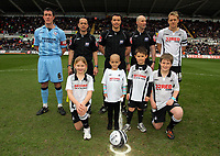 ATTENTION SPORTS PICTURE DESK<br /> Pictured: Children mascots Lucy Wiemens (2nd L FRONT) before the game.<br /> Re: Coca Cola Championship, Swansea City Football Club v Scunthorpe United at the Liberty Stadium, Swansea, south Wales. Saturday 05 April 2010