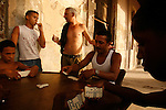 Domino players in the shade of a bulding's colonade near the Malecon ,Havana,Cuba.