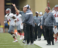 STAFF PHOTO ANTHONY REYES &bull; @NWATONYR<br /> Charlie Stubbs, center, Nicholls State head coach, laments a missed field goal in the fourth quarter Saturday, Sept. 6, 2014 at Razorback Stadium in Fayetteville. The Hogs won 73-7.