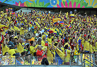 BELO HORIZONTE - BRASIL -14-06-2014. Hinchas colombianos viven una fiesta en el estadio Mineirao de Belo Horizonte durante el partido del Grupo C entre Colombia (COL) y Grecia (GRC) hoy 14 de junio de 2014 en la Copa Mundial de la FIFA Brasil 2014./ Fans of Colombia live a party live a praty in the Mineirao stadium in Belo Horizonte during the match of the Group C between Colombia (COL) and Grece(GRC) today June 14 2014 in the 2014 FIFA World Cup Brazil. Photo: VizzorImage / Alfredo Gutiérrez / Contribuidor
