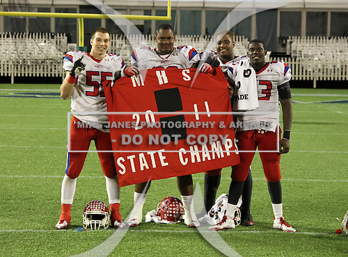 Manatee Hurricanes Blake Keller #55, DeMarcus Christmas #90, unidentified player, and Marquis Dawsey #43 pose for photos after the Florida High School Athletic Association 7A Championship Game at Florida's Citrus Bowl on December 16, 2011 in Orlando, Florida.  Manatee defeated First Coast 40-0.  (Photo By Mike Janes Photography)