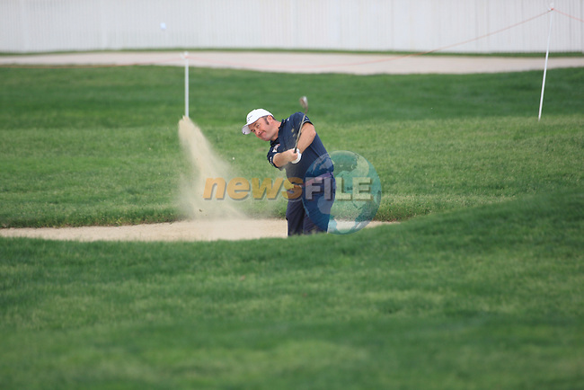 Damien McGrane playing out of the bunker on the first fairway on day one of the Abu Dhabi HSBC Golf Championship 2011, at the Abu Dhabi golf club, UAE. 20/1/11..Picture Fran Caffrey/www.golffile.ie.