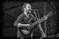 Dave Matthews performs in the rain on the Acura Stage during the 2013 New Orleans Jazz & Heritage Music Festival at Fair Grounds Race Course on April 28, 2013 in New Orleans, Louisiana. USA.