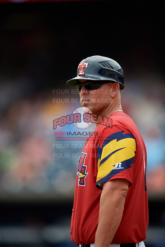 Toledo Mud Hens coach Doug Mientkiewicz (16) during an International League game against the Durham Bulls on July 16, 2019 at Fifth Third Field in Toledo, Ohio.  Durham defeated Toledo 7-1.  (Mike Janes/Four Seam Images)