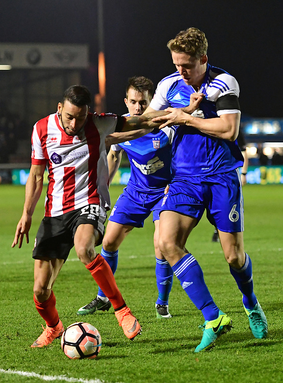 Lincoln City's Nathan Arnold vies for possession with Ipswich Town's Christophe Berra<br /> <br /> Photographer Chris Vaughan/CameraSport<br /> <br /> Emirates FA Cup Third Round Replay - Lincoln City v Ipswich Town - Tuesday 17th January 2017 - Sincil Bank - Lincoln<br />  <br /> World Copyright &copy; 2017 CameraSport. All rights reserved. 43 Linden Ave. Countesthorpe. Leicester. England. LE8 5PG - Tel: +44 (0) 116 277 4147 - admin@camerasport.com - www.camerasport.com