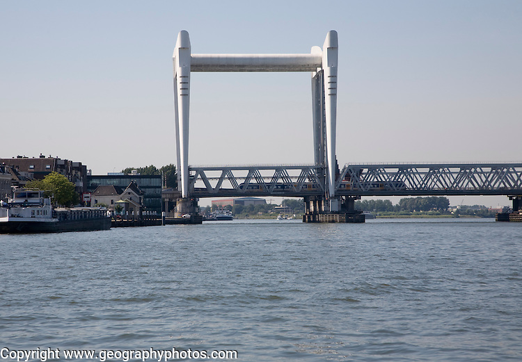 Spoorbrug or railway bridge over Oude Maas river at Dordrecht, Netherlands which is raised to allow shipping to pass.