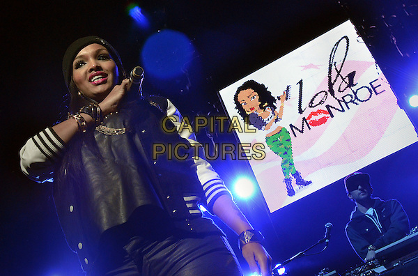 """Rapper LOLA MONROE performs on the last stop of Wiz Khalifa's """"2050 Tour"""" held at the Consol Energy Center, Pittsburgh, PA., USA..December 12th, 2012.on stage in concert live gig performance performing music half length black beanie hat varsity jacket white sleeves top hand arm         .CAP/ADM/JN.©Jason L Nelson/AdMedia/Capital Pictures."""
