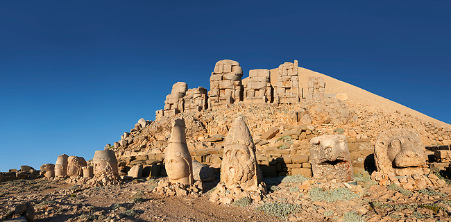 Statue heads, from right,  Eagle, Herekles, Apollo, Zeus, Commagene, Antiochus, & Eagle, with headless seated statues in front of the stone pyramid 62 BC Royal Tomb of King Antiochus I Theos of Commagene, east Terrace, Mount Nemrut or Nemrud Dagi summit, near Adıyaman, Turkey