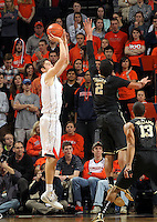 Virginia forward/center Mike Tobey (10) shoots over Wake Forest forward Devin Thomas (2) during the first half of an NCAA basketball game Wednesday Jan. 08, 2014 in Charlottesville, VA. (Photo/The Daily Progress/Andrew Shurtleff)