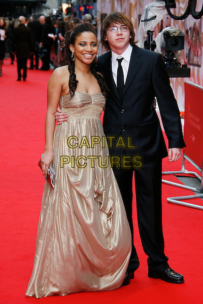 LARISSA WILSON & MIKE BAILEY.Red Carpet Arrivals for the British Academy Television Awards 2008, held at the London Palladium, London, England, .April 20th 2008. .BAFTA BAFTA's full length gold dress black suit tie strapless .CAP/DAR.©Darwin/Capital Pictures.