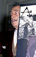 """portrait of Salvador Dali in his suite at hotel Maurice Paris,<br /> 1973<br /> <br /> <br />  - Salvador Domènec Felip Jacint Dalí i Domènech, Marquis de Púbol (May 11, 1904 – January 23, 1989), commonly known as Salvador Dalí  was a prominent Spanish Catalan surrealist painter born in Figueres.<br /> <br /> Dalí was a skilled draftsman, best known for the striking and bizarre images in his surrealist work. His painterly skills are often attributed to the influence of Renaissance masters.His best-known work, The Persistence of Memory, was completed in 1931. Dalí's expansive artistic repertoire includes film, sculpture, and photography, in collaboration with a range of artists in a variety of media.<br /> <br /> Dalí attributed his """"love of everything that is gilded and excessive, my passion for luxury and my love of oriental clothes to a self-styled """"Arab lineage,"""" claiming that his ancestors were descended from the Moors.<br /> <br /> Dalí was highly imaginative, and also had an affinity for partaking in unusual and grandiose behavior. His eccentric manner and attention-grabbing public actions sometimes drew more attention than his artwork to the dismay of those who held his work in high esteem and to the irritation of his critics -"""