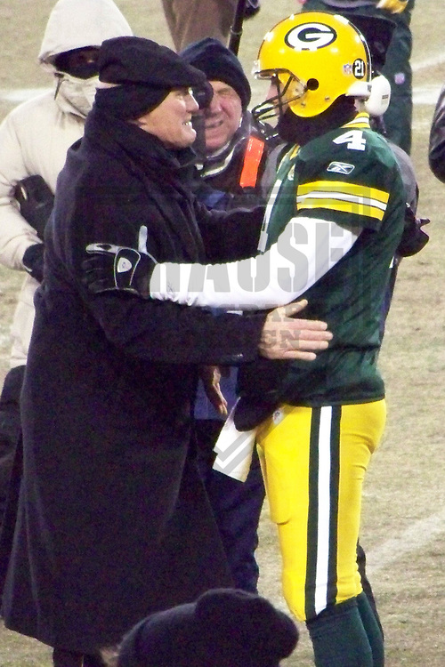 GREEN BAY - JANUARY 2008: Brett Favre #4 of the Green Bay Packers greets Terry Bradshaw prior to the NFC Championship game on January 20, 2008 at Lambeau Field in Green Bay, Wisconsin. (Photo by Brad Krause)