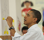 United States President Barack Obama participates in a community service event at the Stuart Hobson Middle School Service Project in Washington, D.C. on Monday, January 17, 2011 to honor the birthday of Dr. Martin Luther King Jr. .Credit: Dennis Brack / Pool via CNP