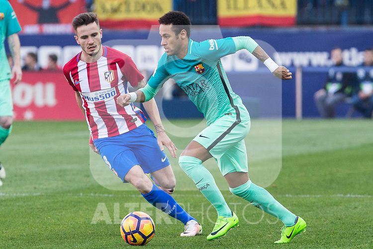 Saul Iniguez of Atletico de Madrid competes for the ball with Neymar Santos Jr of Futbol Club Barcelona during the match of Spanish La Liga between Atletico de Madrid and Futbol Club Barcelona at Vicente Calderon Stadium in Madrid, Spain. February 26, 2017. (ALTERPHOTOS)