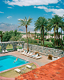 USA, California, Death Valley, woman diving in swimming pool, Furnace Creek Inn