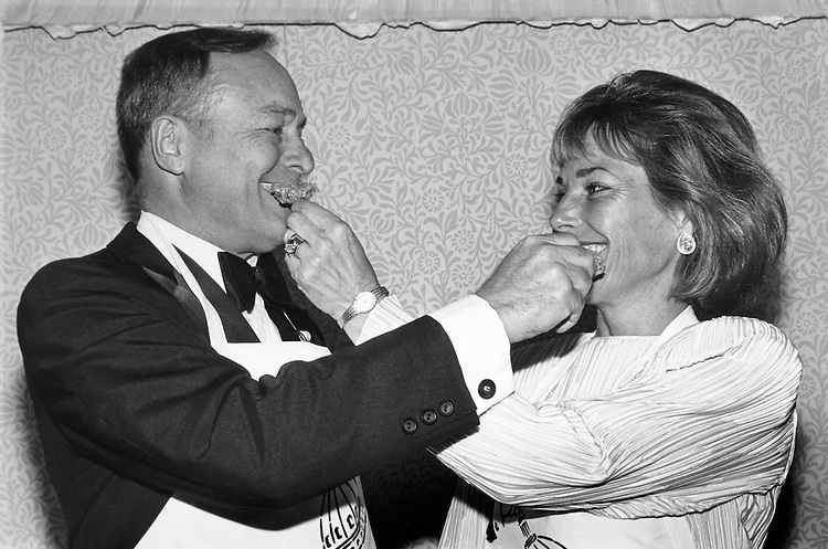 Rep. William Reynolds Archer, R-Tex. with his wife Sharon Sawyer, feeding each other curried peanut chicken. March 21, 1991. (Photo by Laura Patterson/CQ Roll Call)
