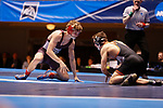 CLEVELAND, OH - MARCH 10: Sam Bennyhoff, of Augsburg, left, wrestles Brock Rathbun, of Wartburg, in the 133 weight class during the Division III Men's Wrestling Championship held at the Cleveland Public Auditorium on March 10, 2018 in Cleveland, Ohio. Rathbun went on to place first in the 133 weight class.  (Photo by Jay LaPrete/NCAA Photos via Getty Images)