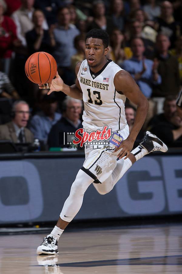 Bryant Crawford (13) of the Wake Forest Demon Deacons pushes the ball up the court during first half action against the Xavier Musketeers at the LJVM Coliseum on December 22, 2015 in Winston-Salem, North Carolina.  (Brian Westerholt/Sports On Film)