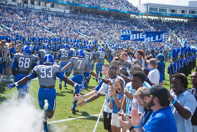 Kentucky players exit the tunnel prior to the University of Kentucky vs. Ohio University football game at Commonwealth Stadium in Lexington, Ky., on Saturday, September 6, 2014. Kentucky defeated Ohio 20-3. Photo by Adam Pennavaria | Staff