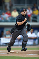 Home plate umpire Josh Gilreath hustles down the first base line during the South Atlantic League game between the Kannapolis Intimidators and the Augusta GreenJackets at SRG Park on July 6, 2019 in North Augusta, South Carolina. The Intimidators defeated the GreenJackets 9-5. (Brian Westerholt/Four Seam Images)