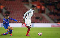 Nathaniel Chalobah (Chelsea) of England leaves Alberto Grassi (Atalanta (on loan from Napoli) of Italy during the Under 21 International Friendly match between England and Italy at St Mary's Stadium, Southampton, England on 10 November 2016. Photo by Andy Rowland.