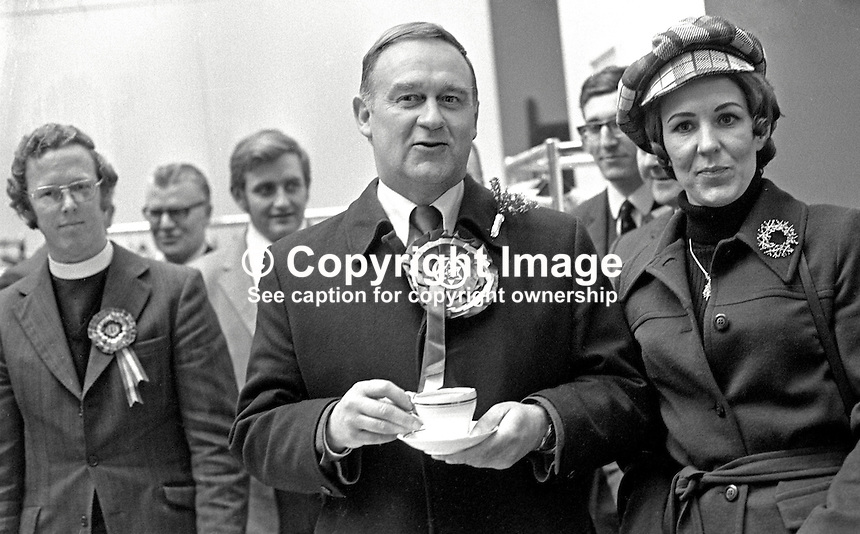 Vanguard Unionist politician, William Craig, at City Hall, Belfast, N Ireland, to hand in his nomination papers for the East Belfast seat in the 28th February 1974 UK General Election. He is accompanied by his German-born wife, Doris. 197402180130a. Also in the photo is Rev Robert Bradford, who was standing in the South Belfast seat. Both went on to win their seats. Bradford who was re-elected in a subsequent general election was shot dead in a local community centre by the Provisional IRA in November 1981.<br />