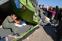 Pireus / Athens 31/3/2016<br /> Distribution of food organized by volunteers in refugee camp 2 in Pireus port.<br /> 6000 are living in tents waiting opening of borders between Greece and Makedonia.<br /> Photo Livio Senigalliesi