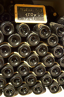 Bottles aging in the cellar. Muntada magnum. Domaine Gauby, Calces, roussillon, France