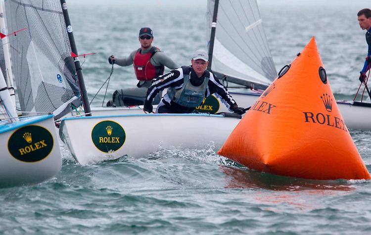 Finn fleet at the windward mark