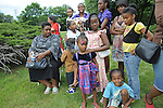 Relatives and families of those who buried their loved ones at  the street from the historically black Burr Oak Cemetery attend a prayer vigil across the street from Burr Oak in Alsip, Illinois on July 12, 2009.  On July 9, four managers and caretakers at the historically black Burr Oak Cemetery were arrested on charges of fraud and dismembering human remains; as families descended upon the site in search for answers, investigators were forced to close down the site as more dismembered human remains were discovered.