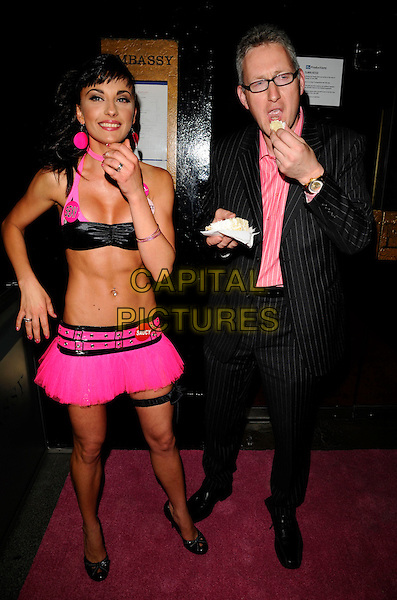 GABRIELLA IRIMIA, LEMBIT OPIK .The Cheeky Girls celebrate 6 years of their career with a party at Embassy club in London, England, June 10th 2008..full length pink black bra top halterneck mini skirt garter sexy badges twins sisters crop tummy midriff cake pinstripe suit glasses eating couple.CAP/CAN.©Can Nguyen/Capital Pictures