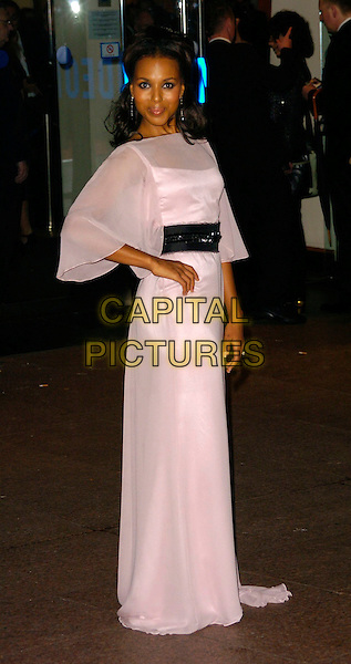 """KERRY WASHINGTON.The Times BFI London Film Festival opening night with the screening of """"The Last King Of Scotland"""" at the Odeon Leicester Square, London, UK..October 18th, 2006.Ref: CAN.full length white sheer dress hand on hip black belt.www.capitalpictures.com.sales@capitalpictures.com.©Can Nguyen/Capital Pictures"""