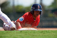 Boston Red Sox Yeison Coca (11) dives back to first base during an Instructional League game against the Baltimore Orioles on September 22, 2016 at the Ed Smith Stadium in Sarasota, Florida.  (Mike Janes/Four Seam Images)