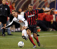 The Burn's Brad Davis gets fouled by the MetroStars' Ricardo Clark during scoreless first half action between the Dallas Burn and  the NY/NJ MetroStars at Giant's Stadium, East Rutherford, NJ, on June 5, 2004.
