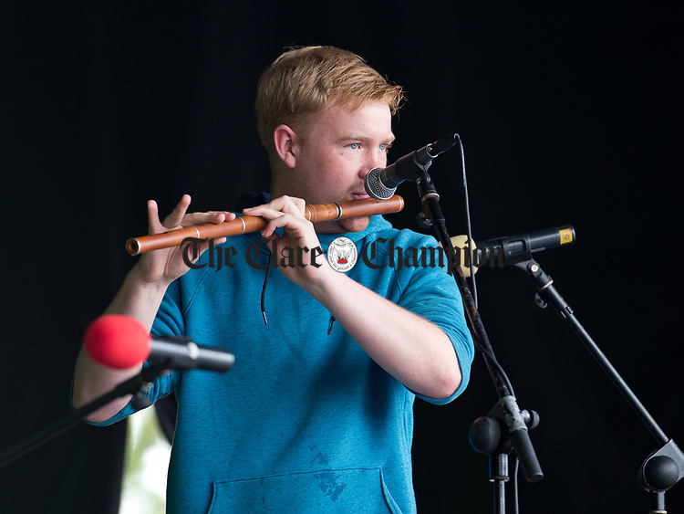 Oisin Mc Cann playing on stage in Abbey Street car Park during a wet final Sunday of the All-Ireland Fleadh in Ennis. Photograph by John Kelly.
