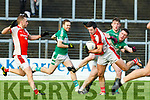 Aidan O'Mahony Rathmore wins the ball ahead of Shaun Keane Legion during the East Kerry final on Sunday