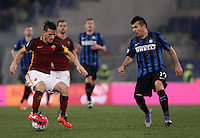 Calcio, Serie A: Roma vs Inter. Roma, stadio Olimpico, 19 marzo 2016.<br /> Roma&rsquo;s Alessandro Florenzi, left, is challenged by FC Inter&rsquo;s Gary Medel during the Italian Serie A football match between Roma and FC Inter at Rome's Olympic stadium, 19 March 2016. The game ended 1-1.<br /> UPDATE IMAGES PRESS/Isabella Bonotto
